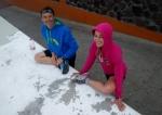 Sebastian Chaigneau & fernanda Maciel streching before Transgrancanaria 2012