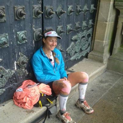 The Camino finishes at Santiago de Compostela. Fernanda Maciel savouring the moment.