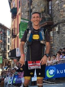 javi dominguez crossing the finish line to win 168k ehunmilak
